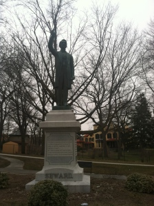 Seward statue in Seward Park in Auburn, NY.  The house museum is in the background.